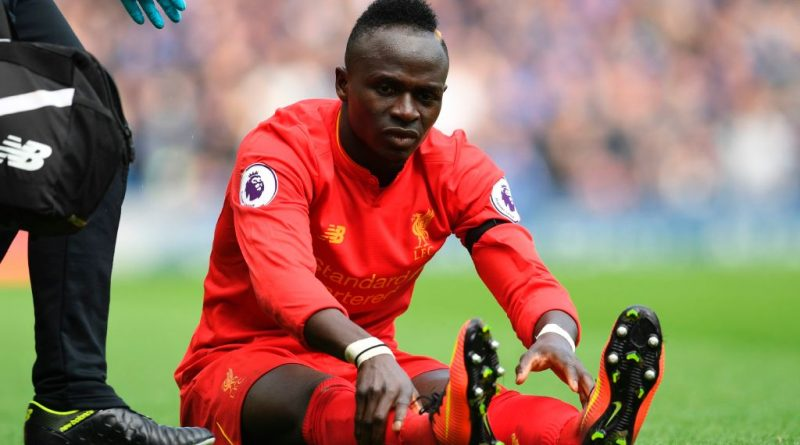 Liverpool's Senegalese midfielder Sadio Mane reacts after picking up an injury during the English Premier League football match between Liverpool and Everton at Anfield in Liverpool, north west England on April 1, 2017. / AFP PHOTO / Paul ELLIS / RESTRICTED TO EDITORIAL USE. No use with unauthorized audio, video, data, fixture lists, club/league logos or 'live' services. Online in-match use limited to 75 images, no video emulation. No use in betting, games or single club/league/player publications.  /         (Photo credit should read PAUL ELLIS/AFP/Getty Images)
