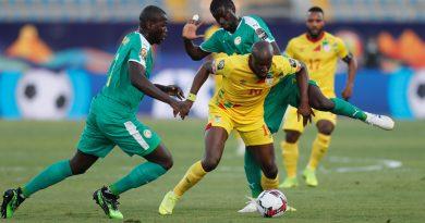 Soccer Football - Africa Cup of Nations 2019 - Quarter Final - Senegal v Benin - 30 June Stadium, Cairo, Egypt - July 10, 2019  Senegal's Badou N'Diaye in action with Benin's Mickael Pote     REUTERS/Mohamed Abd El Ghany