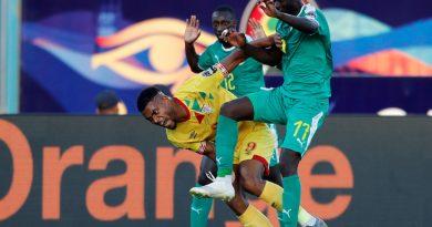 Soccer Football - Africa Cup of Nations 2019 - Quarter Final - Senegal v Benin - 30 June Stadium, Cairo, Egypt - July 10, 2019  Benin's Steve Mounie in action with Senegal's Badou N'Diaye       REUTERS/Mohamed Abd El Ghany